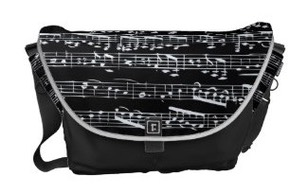 A Rickshaw messenger bag featuring sheet music with music notes in white on black. Ideal gift for a musician or pianist to keep music notation and sheet music in.